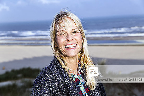 Portrait of happy woman at the sea