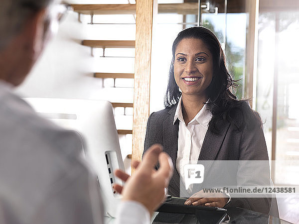 Portrait of smiling businesswoman in a meeting