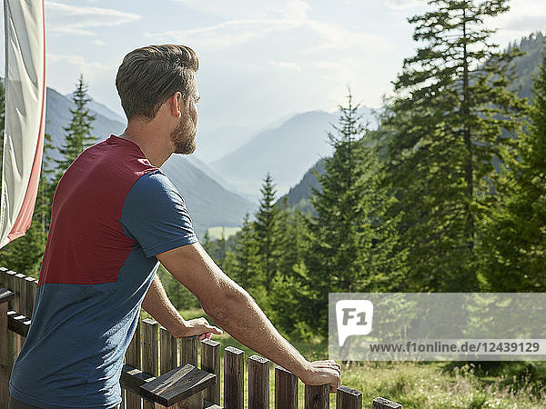 Austria  Tyrol  Mieming  man looking at view in the mountains