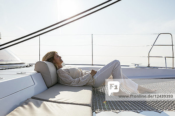 Mature woman relaxing on a sailing trip Mature woman relaxing on a sailing trip