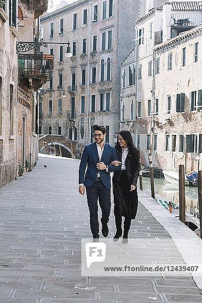 Italy  Venice  happy couple walking in the city