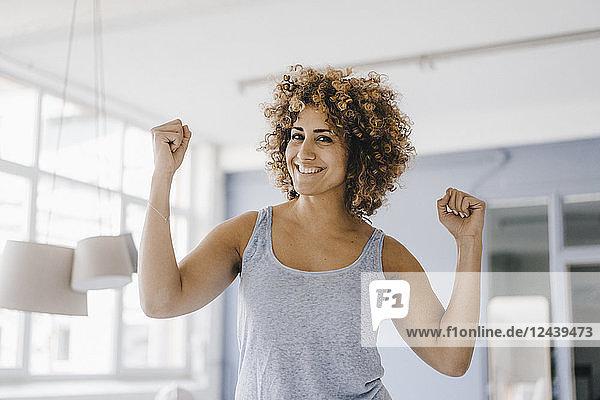 Power woman flexing muscles  portrait