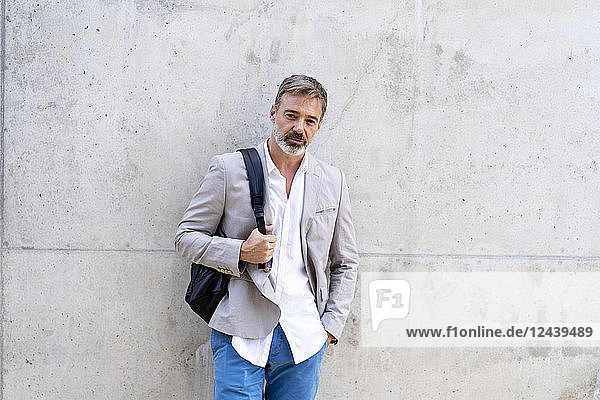 Portrait of casual businessman with backpack