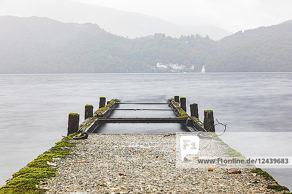 UK  Scotland  wreck of a pier going into a lake in the highlands