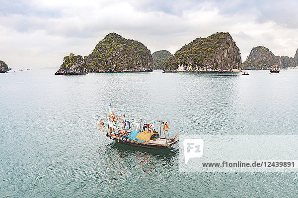Vietnam  Ha Long bay  with limestone islands and small boat