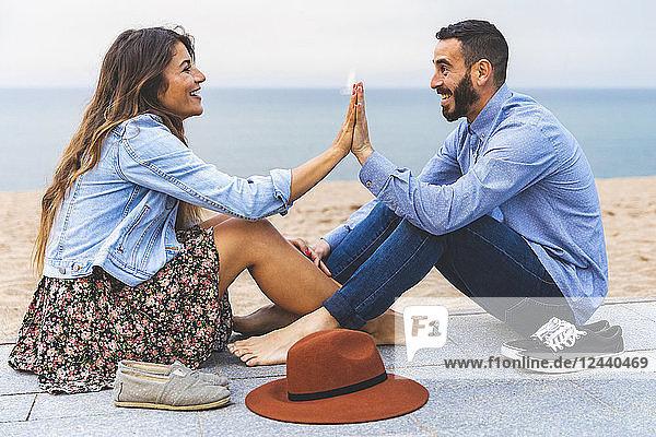 Spain  Barcelona  couple having fun together on the beach