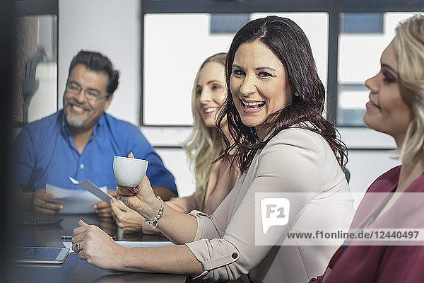 Happy businesswoman on a meeting in conference room