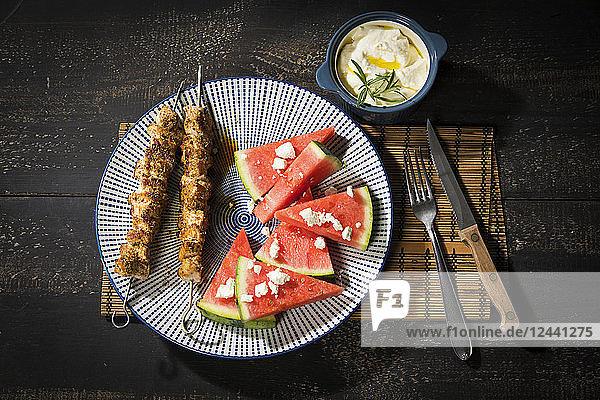 Souvlaki  grilled pork meat skewers  water melon  feta and garlic cream