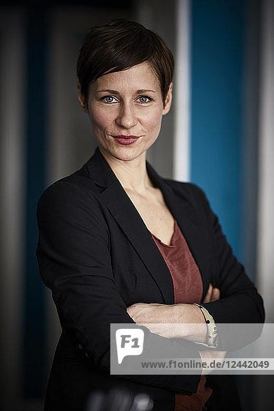 Portrait of a businesswoman leaning in door