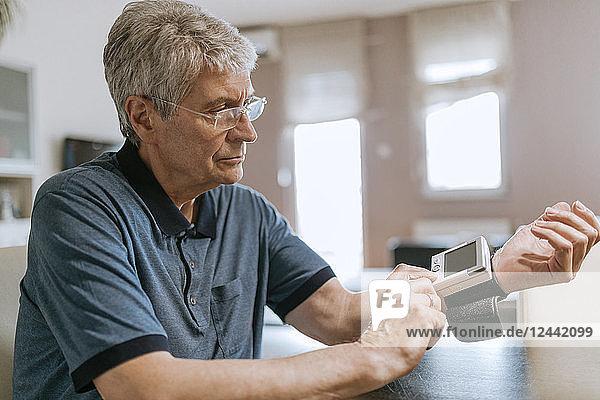 Senior man taking his blood pressure