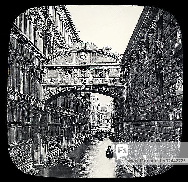 Bridge of Sighs along the Palace Canal and views of Doge's Palace. Venice  circa 1900 on a magic lantern slide  photographs created in 1888 by Joseph John William; Venice  Italy