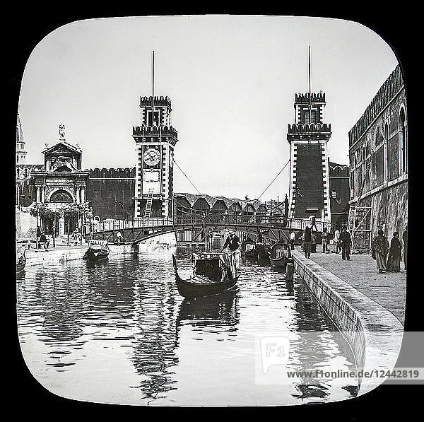 The Arsenal  Venice circa 1900 on a magic lantern slide  photograph created in 1888 by Joseph John William. Boats in the canal and pedestrians along the waterfront; Venice  Italy