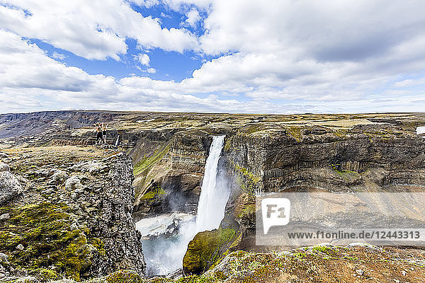 A gorgeous high angle landscape viewpoint overlooking the Haifoss waterfall valley,  a popular hiking destination for travellers in Iceland,  Iceland