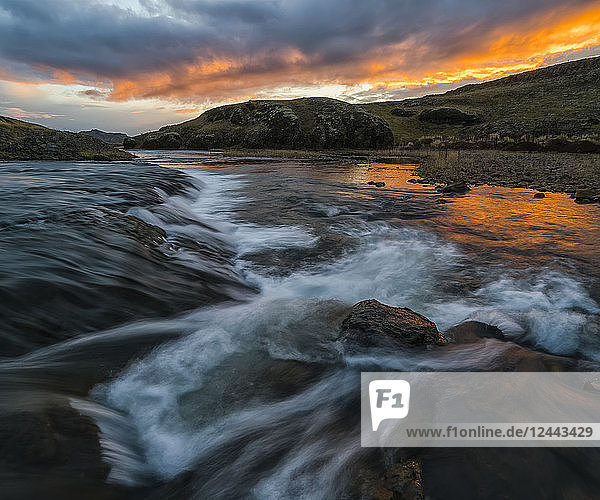 Stunning sunset over an unnamed creek in remote Iceland  Iceland