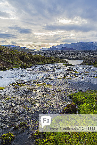 A gorgeous fresh water river runs through a valley in Western Iceland  Iceland