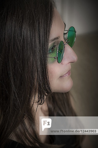 Woman wearing round green glasses  Connecticut  United States of America