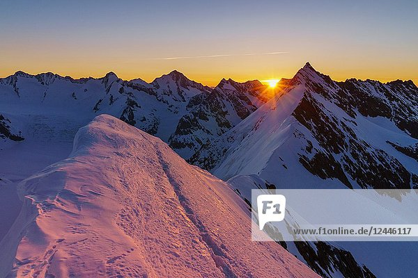 Aletschorn sunrise with red light on the snow East ridge. Aletschorn  Vallese  Switzerland  Europe.