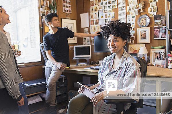 Portrait smiling  confident creative female designer with digital tablet in office