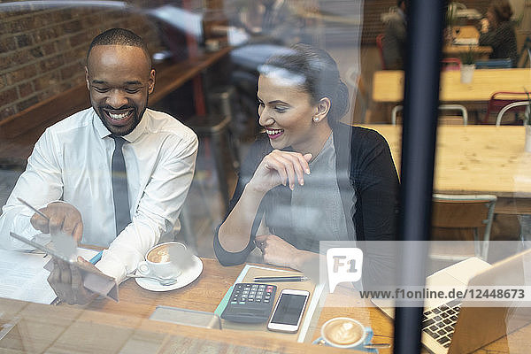Business people working at cafe window