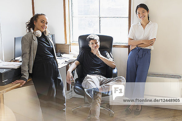 Portrait confident creative business people in office