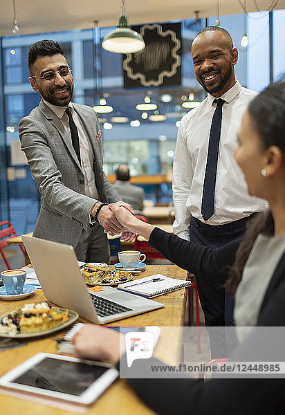 Business people handshaking  working in cafe