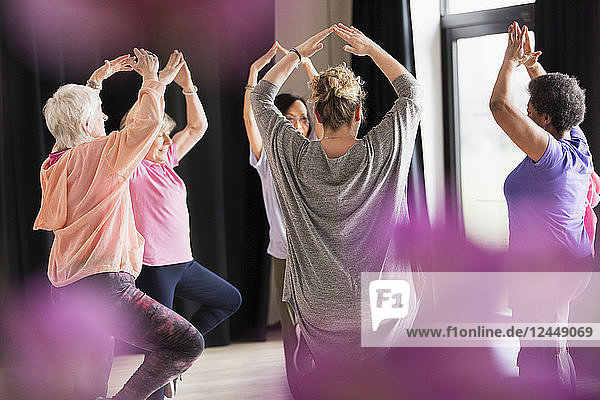 Active seniors exercising in circle