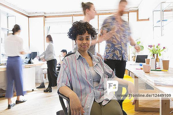 Portrait confident creative businesswoman working in office