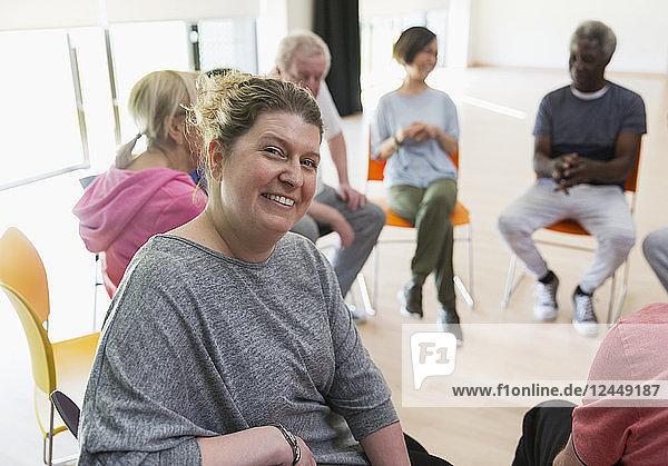 Portrait smiling instructor leading active senior exercise class