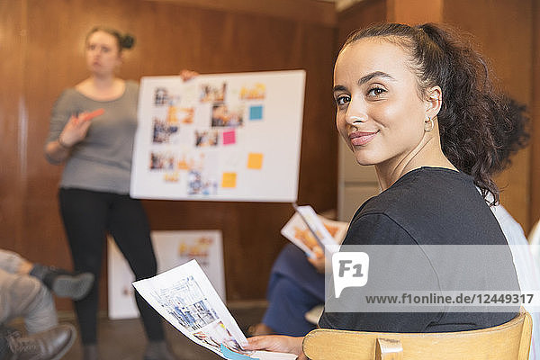 Portrait confident creative female designer in meeting