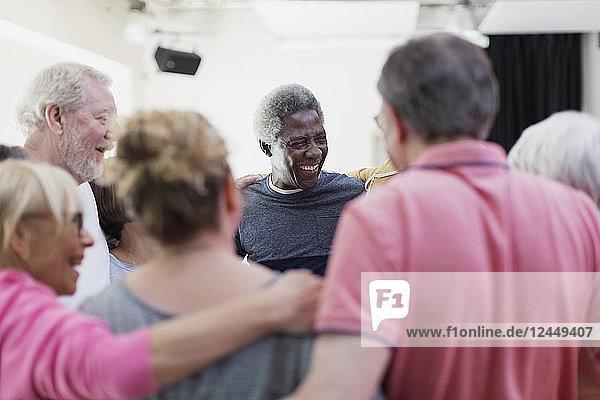 Active seniors forming circle huddle