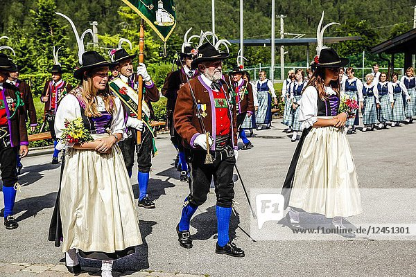 Tyrolean Militia men and maidens march out of the village square on Patronage day in Reith bei Seefeld  Austria.