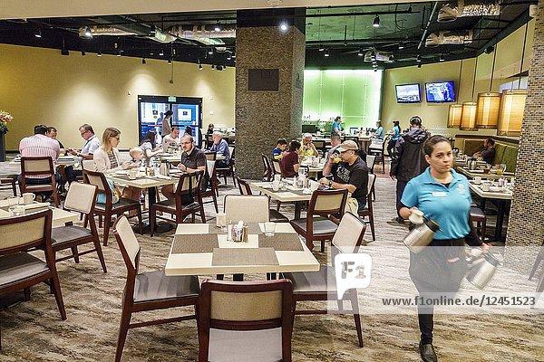 Florida  Orlando  Doubletree by Hilton Orlando SeaWorld  hotel  property grounds  Laguna  restaurant  tables  family  Hispanic  woman  waitress  interior