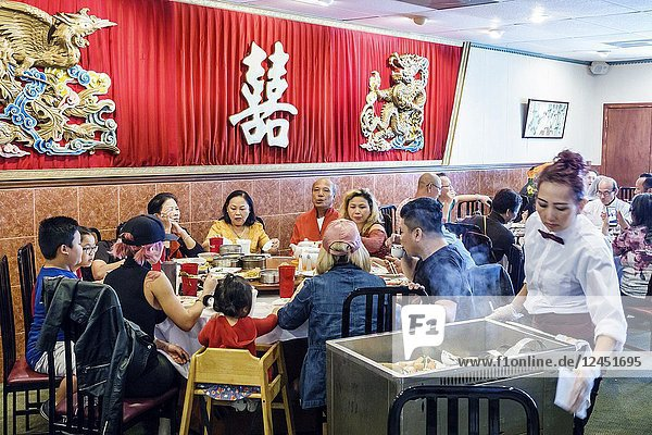 Florida  Orlando  Chinatown  Lam's Garden Chinese  restaurant  dim sum  ethnic  dining  large family  table  Asian  man  woman  girl  boy  child  high chair  waitress  cart  server  interior