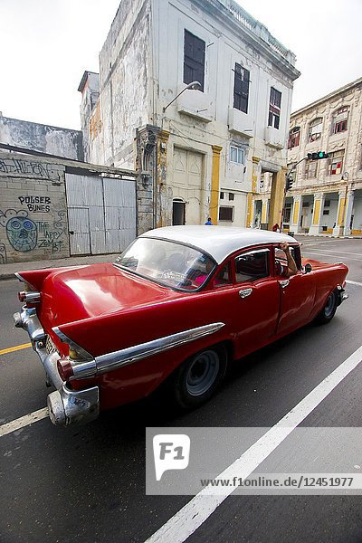 Classic American car driving by Malecon. La Havana. Cuba.