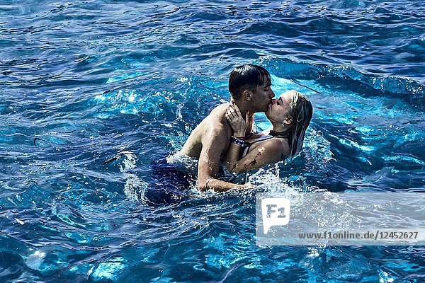 Greece  Crete  Chersonissos  fierce couple kissing in sea