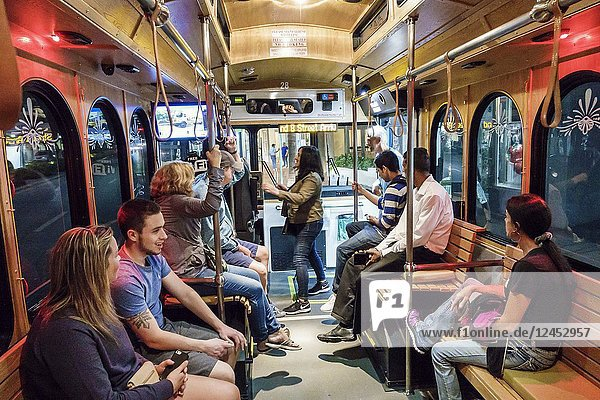 Florida  Miami Beach  South Beach Loop free trolley  public transportation  onboard  passengers  night nightlife  man  woman