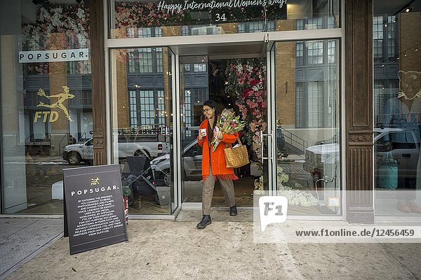 Visitors to a pop-up in the Meatpacking District in New York are treated to free bouquets courtesy of both FTD and PopSugar in celebration of International Women's Day on Thursday  March 8  2018. The day celebrates the achievements of women in the social  cultural political and economic spheres.