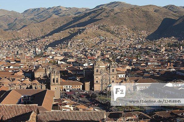 View from above to the Cathedral of Cusco and Iglesia De La Compania De Jesus-La Compania De Jesus Church at Plaza de Armas Square and to the buildings in the city center  Cusco  Peru  South America