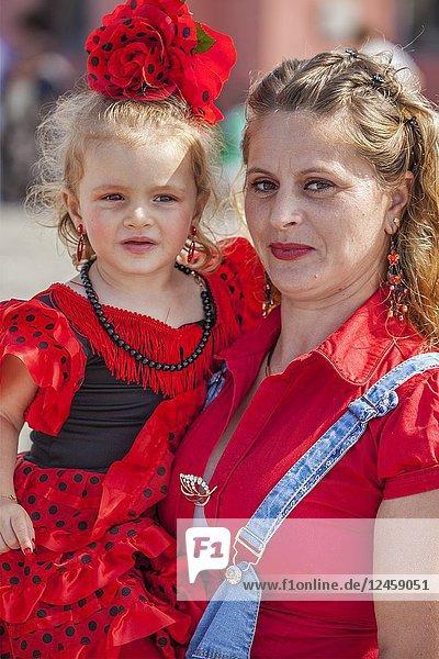 Mother and daughter in procession at Romeria fiesta in Salobreña  Granada  Spain.