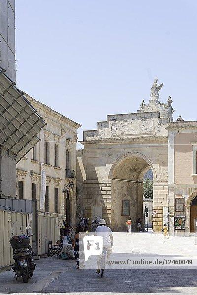 Cityscape in Lecce on July 13  2018 Puglia Italy. Porta Rudiae gate of the old wall.