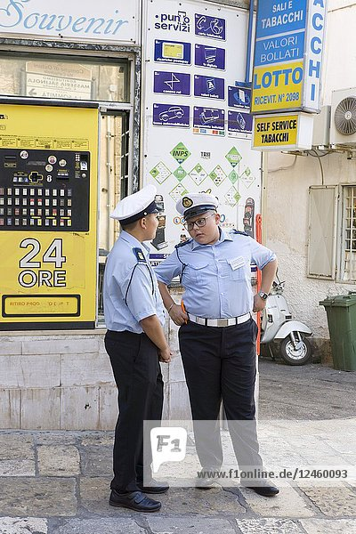 Cityscape in Ostuni Brindisi Puglia Italy on July 13  2018. A couple of young policemen at street.