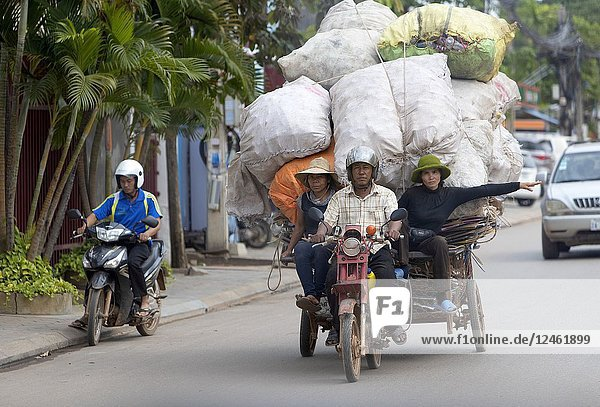 Transporting garbage on his motorcycle  Siem reap Province  Kingdon of Cambodia.