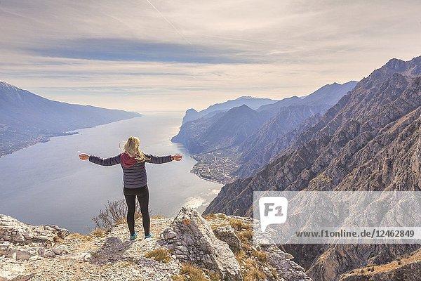 A young tourist on the top of Cima Larici. Pregasina  Riva del Garda  Garda Lake  Trento province  Trentino Alto Adige  Italy  Europe.