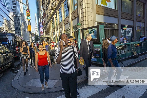 A woman on her smartphone in a busy intersection in Times Square in New York on Tuesday  June 19  2018. (© Richard B. Levine).