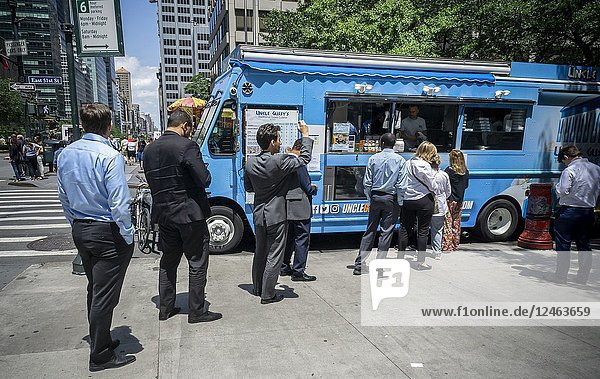 Loyal customers line up at Uncle Gussy's food truck in Midtown Manhattan in New York on Tuesday  June 26  2018. The truck  one of the ubiquitous food trucks that have sprung up  serves Greek and Mediterranean cuisine to its loyal followers. (© Richard B. Levine).