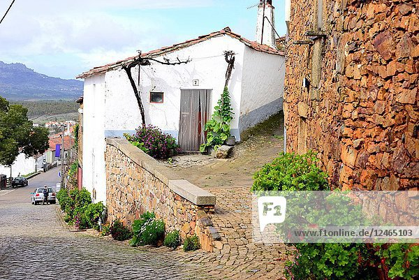 White house and wall in Penha Garcia  Castelo Branco province  Portugal.