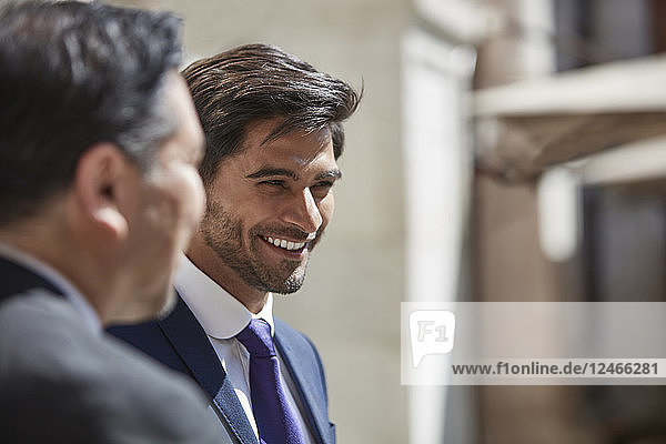 Businessman listening to colleagues