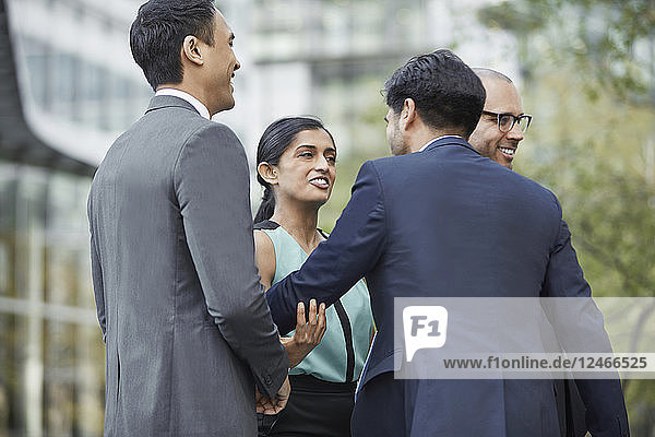 Businesspeople greeting each other at business park