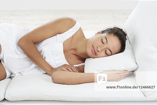 Woman lying down on pillow  asleep.