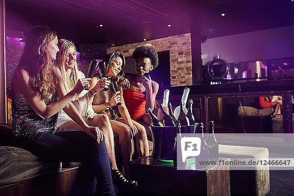 Friends sitting together at nightclub